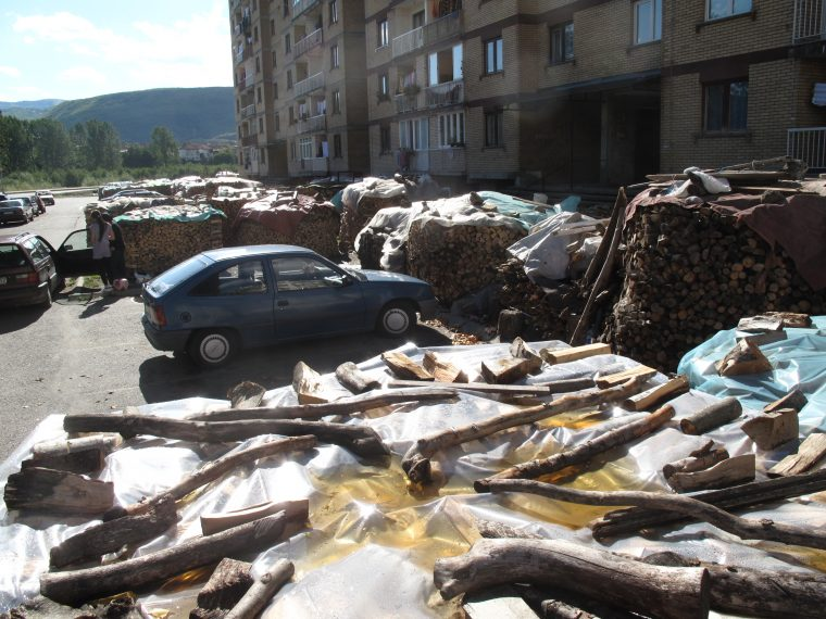 Stockpiles of wood near an appartment building in Montenegro.